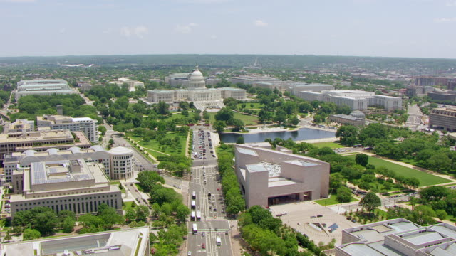 WS AERIAL POV View over Pennsylvania Avenue towards US Capitol building / Washington DC, United States