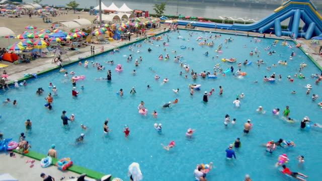 ws aerial view over people enjoying at hangang river outdoor pool / seoul, south korea - water slide stock videos & royalty-free footage