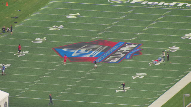 ws aerial view over people playing on field at fawcett stadium at pro football hall of fame / canton, ohio, united states - hall of fame stock videos and b-roll footage