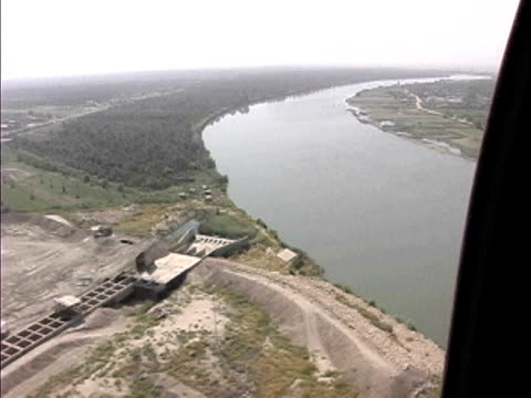 view over power station near euphrates river / baghdad, iraq / audio - 2007 stock videos & royalty-free footage