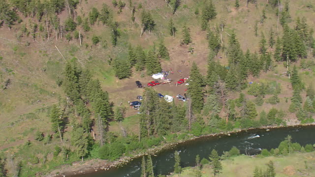 ws aerial view over preparation of scout camp besides river / wyoming, united states - boy scout stock videos and b-roll footage
