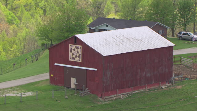 ms aerial view over quilt painted on barn along quilt trail in elliott county / kentucky, united states - barn stock videos & royalty-free footage