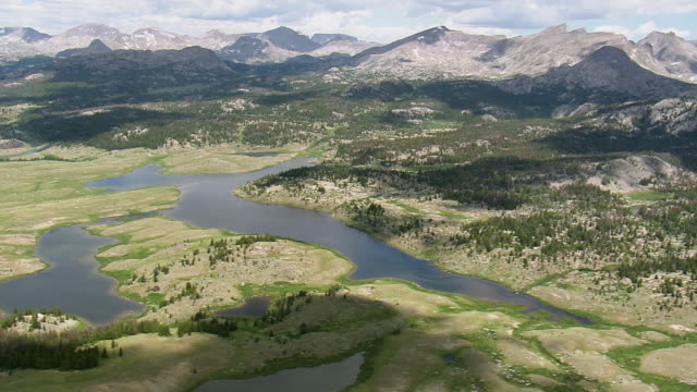 ws aerial view over red lake and mountains with glacier / wyoming, united states - red lake stock videos & royalty-free footage