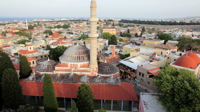 view over rhodes island with rhodes town mosque in the foreground, greece, europe - tornspira bildbanksvideor och videomaterial från bakom kulisserna