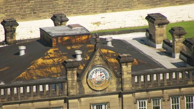 stockvideo's en b-roll-footage met ms ts aerial view over roof emblem on former west virginia state penitentiary building / moundsville, west virginia, united states - virginia amerikaanse staat
