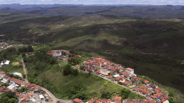 ws aerial view over roof tops in town / minas gerais, brazil - minas stock videos and b-roll footage