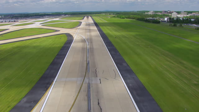 ws aerial pov view over runway at dulles international airport station / washington dc, united states - dulles international airport stock videos and b-roll footage