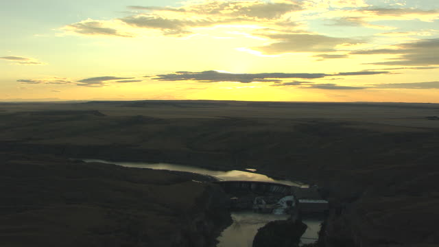 WS AERIAL View over Ryan Falls and Missouri River with open sky / Montana, United States