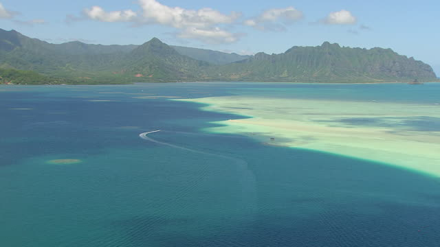 ws aerial view over sand bar on island of oahu / hawaii, united states - oahu stock videos and b-roll footage