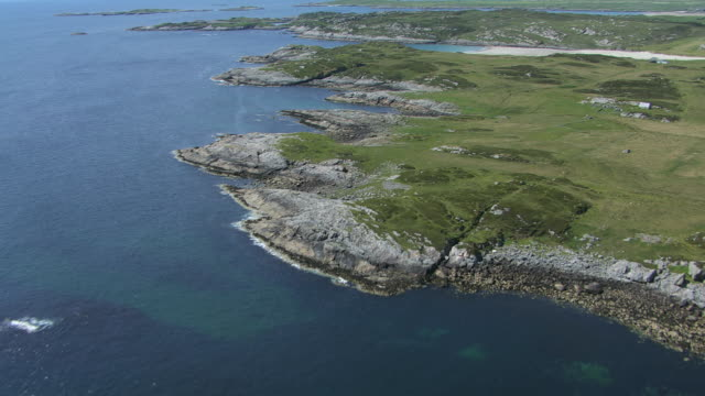 WS AERIAL TU View over sandy beaches and rocky shores / Isle or island of Coll, Argyll and Bute, Scotland