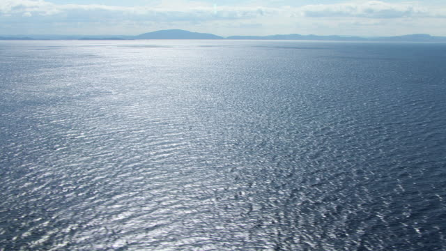 WS AERIAL View over sea surface / Isle or island of Mull, Argyll and Bute, Scotland