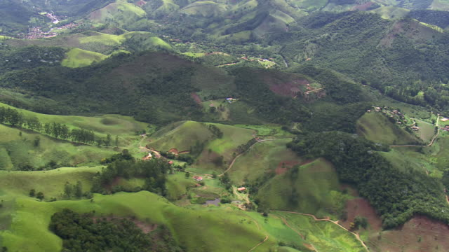 WS AERIAL View over small hills in mist / Bahia, Brazil