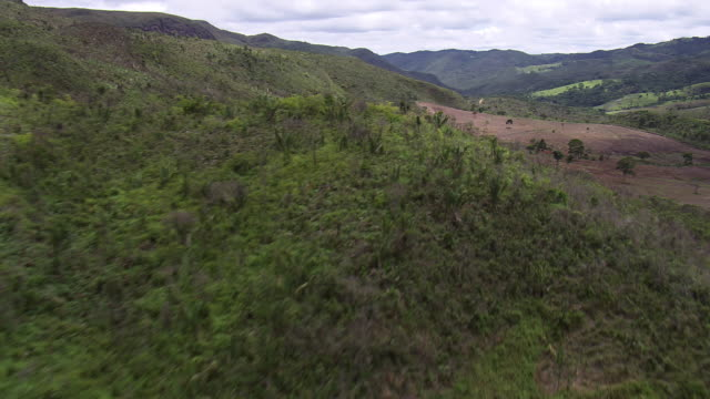ws aerial view over small hills / minas gerais, brazil - minas stock videos and b-roll footage
