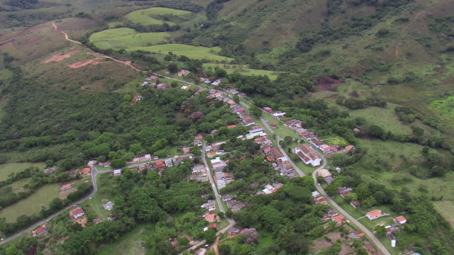 ws aerial ds view over small unknown village / minas gerais, brazil - minas stock videos and b-roll footage