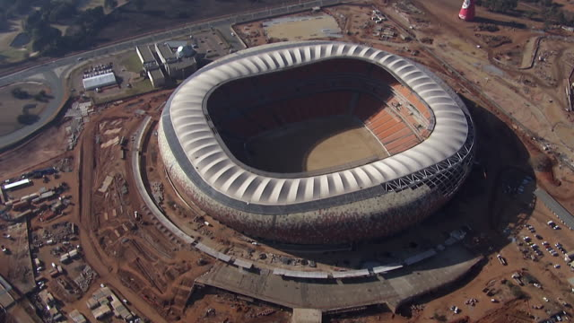 ws aerial ds zi view over soccer city stadium / johannesburg, gauteng, south africa - international soccer event stock videos & royalty-free footage