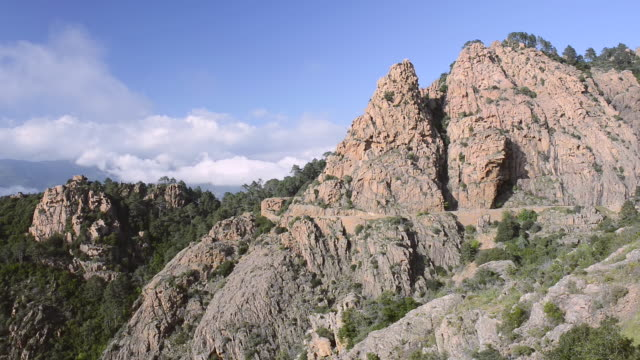 ws view over the fantastic rock landscape of the calanche of piana, unesco world heritage site / gulf of porto, corsica, france - igneous stock videos & royalty-free footage