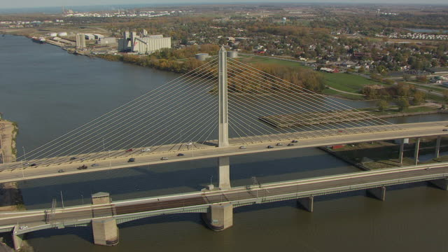 ws td aerial view over toledo skyway bridge over maumee river / toledo, ohio, united states - ohio stock videos & royalty-free footage