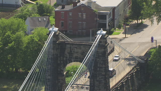 ms zo aerial view over top cables of wheeling suspension bridge in ohio county / wheeling, west virginia, united states - suspension bridge stock videos & royalty-free footage
