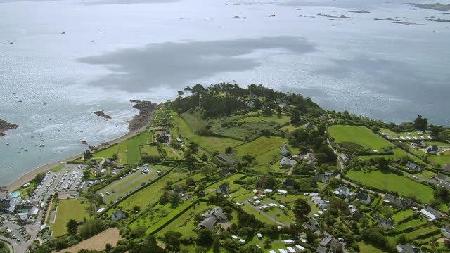 vidéos et rushes de ws aerial view over town and farm area at paimpol / brittany, france - bretagne
