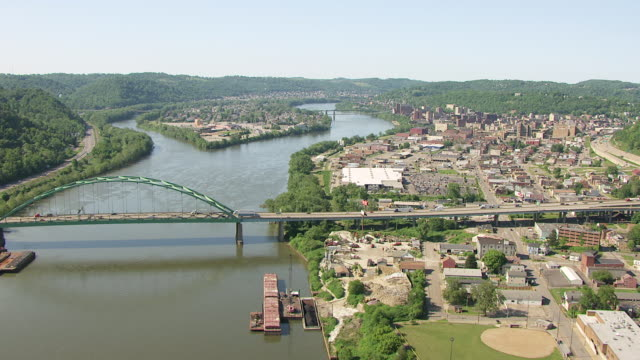 ws aerial view over town and ohio river in ohio county / wheeling, west virginia, united states - suspension bridge stock videos & royalty-free footage
