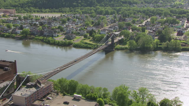 ws zi aerial view over town and wheeling suspension bridge / wheeling, west virginia, united states - suspension bridge stock videos & royalty-free footage