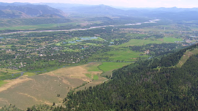 WS AERIAL View over town Jackson and mountains / Wyoming, United States