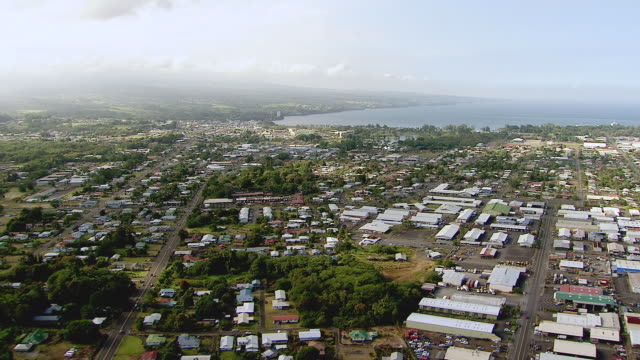 ws aerial view over town of hilo on big island / hilo, hawaii, united states - hilo stock videos & royalty-free footage