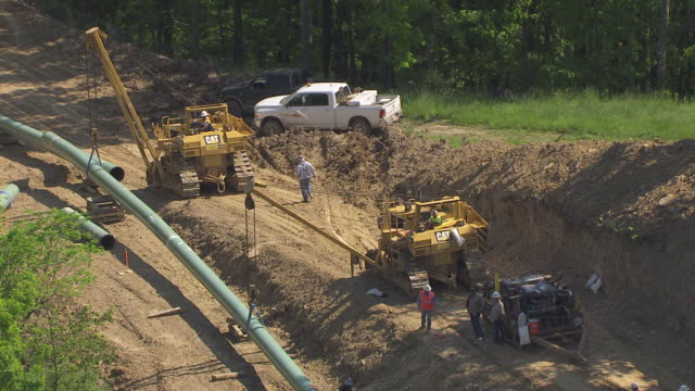 ms zo ts aerial view over tractor and construction workers for chesapeake energy gas pipeline and forest in wetzel county / littleton, west virginia, united states - pipeline stock videos & royalty-free footage