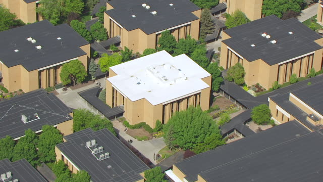MS AERIAL DS ZO View over two men walking outside and Missionary training center at Brigham young university / Provo, Utah, United States