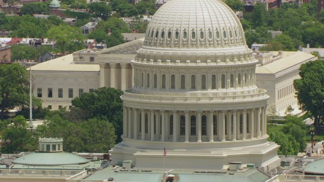 ws aerial pov view over us capitol building to us supreme court / washington dc, united states - supreme court stock videos & royalty-free footage