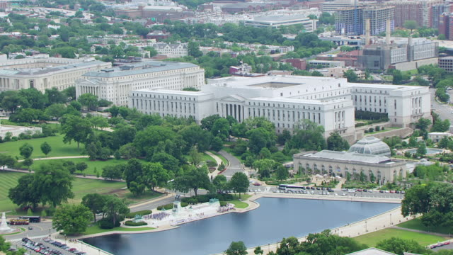 ws aerial pov view over us capitol reflecting pool with u.s. supreme court / washington dc, united states - u.s. supreme court stock videos & royalty-free footage