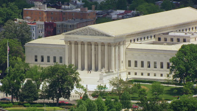 ws aerial pov view over us supreme court and us capitol building / washington dc, united states - oberstes bundesgericht der usa stock-videos und b-roll-filmmaterial