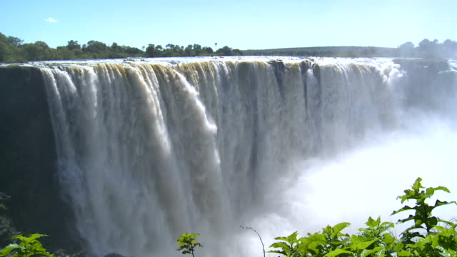 view over victoria falls between zambia and zimbabwe - victoria falls stock videos and b-roll footage