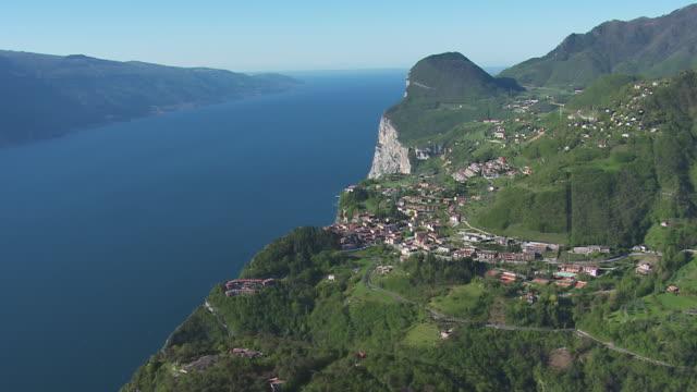 WS View over village situated neighbor lake / Lake Garda, Trentino, Verona, Brescia