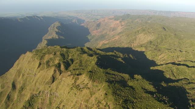 ws aerial view over waimea canyon on island of kauai / hawaii, united states - kauai stock videos and b-roll footage