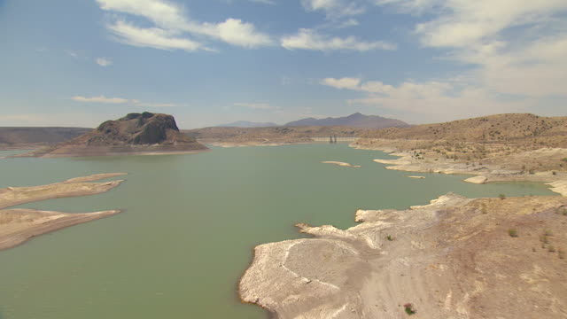 ws aerial td view over water and dam at elephant butte reservoir / new mexico, united states - seeufer stock-videos und b-roll-filmmaterial