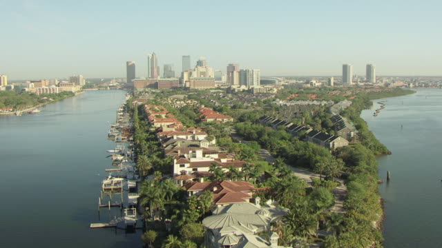 ws aerial view over water and harbor island to downtown / tampa, florida, united states - tampa stock videos & royalty-free footage