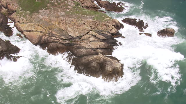 ms aerial view over waves hitting on rock / guernsey, channel isles - guernsey stock videos & royalty-free footage