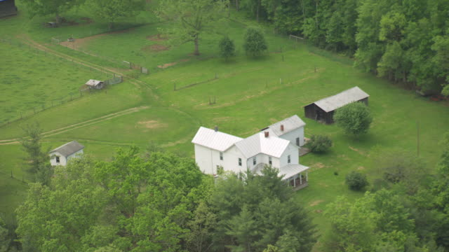 WS AERIAL View over white farm house in Pocahontas County / Green Bank, West Virginia, United States