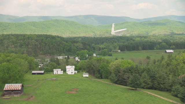 ws aerial view over white farm house with forest in pocahontas county / green bank, west virginia, united states - bank stock-videos und b-roll-filmmaterial