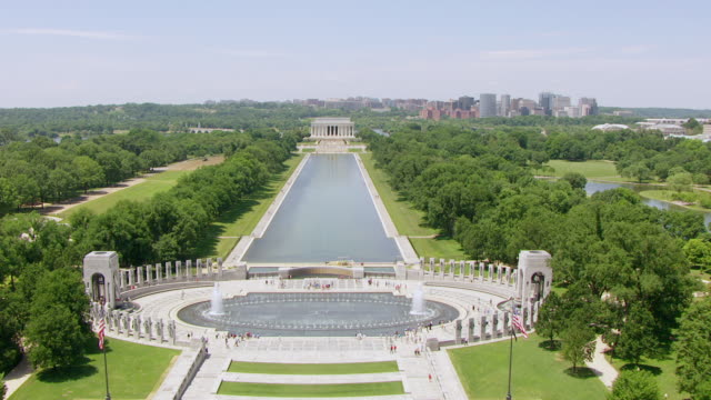 ws aerial pov view over world war ii memorial and reflecting pool to lincoln memorial / washington dc, united states - reflecting pool washington dc stock videos & royalty-free footage