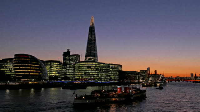 view overlooking city hall and the shard at dusk, london, uk - gla building stock videos & royalty-free footage