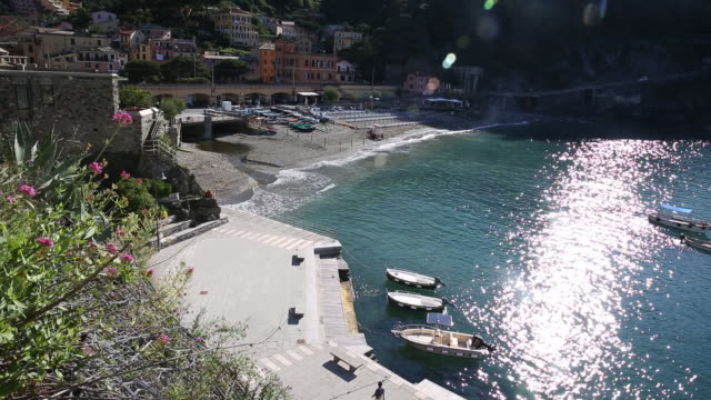 view overlooking small town along the cinque terre - baia video stock e b–roll