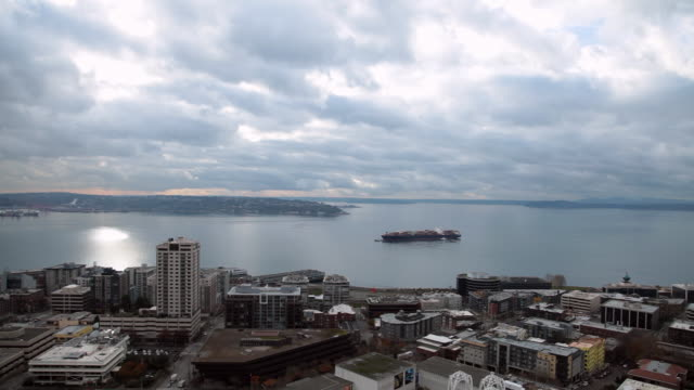 view overlooking the city to puget sound will going down the space needle. - puget sound stock videos & royalty-free footage