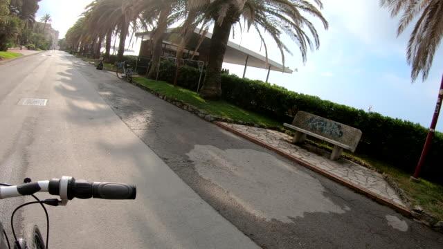 View past bicycle handlebar to sea front promenade