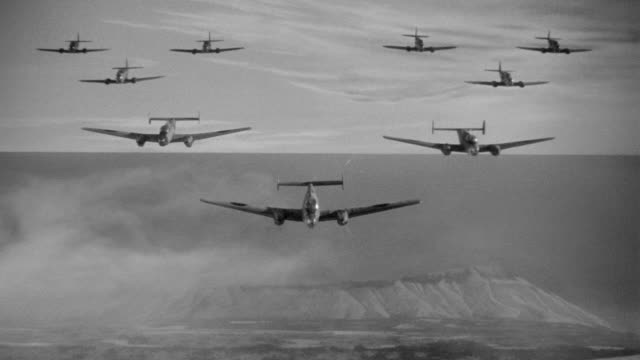 ws ts td aerial view planes in formation on bombing mission - formationsfliegen stock-videos und b-roll-filmmaterial