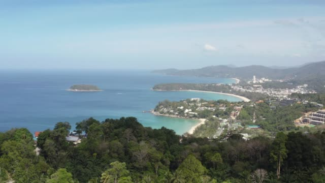 view point of karon beach, kata beach and kata noi in phuket, thailand. beautiful turquoise sea and blue sky from high view point. - phuket stock videos & royalty-free footage