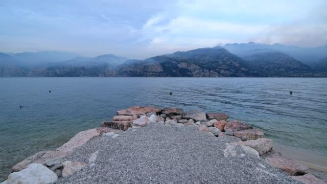 view point on lake in the morning, malcesine, lake garda, lago di garda, veneto, italy - lago stock videos & royalty-free footage
