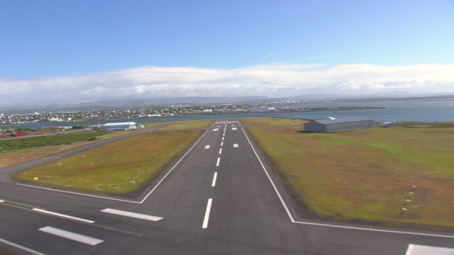 ms aerial view reykjavik airport with town and bay / iceland - reykjavik stock videos and b-roll footage