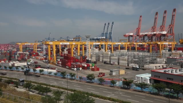 view scene of new container port at busan, south korea.south korea's economy is expected to contract 1.2 percent this year as the coronavirus... - korean new year stock videos & royalty-free footage
